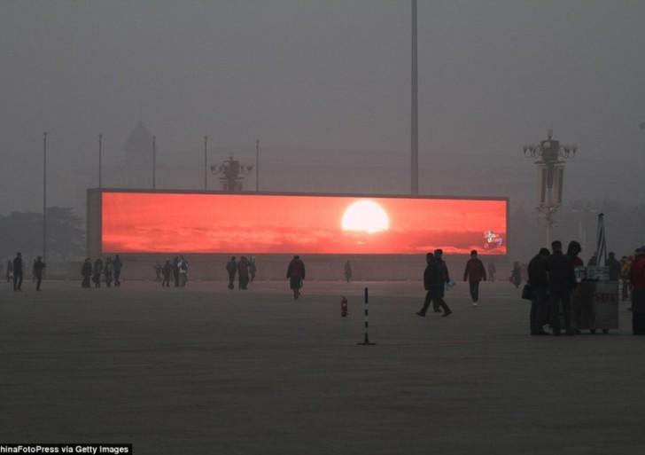 China emite el amanecer en pantallas gigantes por la contaminación