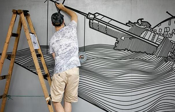 Arte callejero hecho con cinta de aislar por Buff Diss