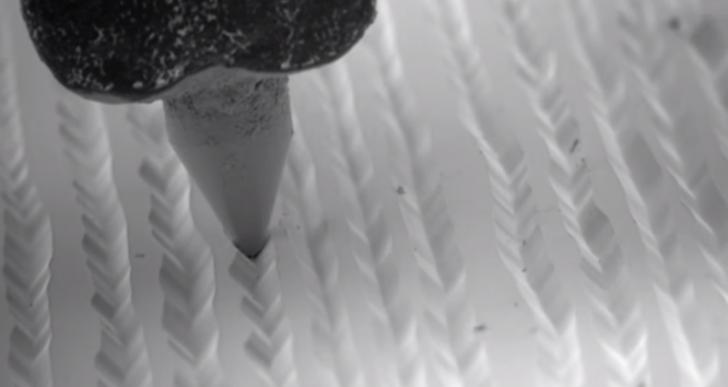 Mira una aguja leer un disco de vinil con detalle microscópico